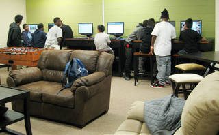 Youth in Oklahoma City's FACT program use the Hathaway Center's computers before dinner and the night's program gets under way.