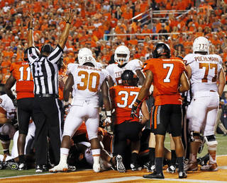 Head linesman Brad Edwards signals touchdown on the game-winning score by Joe Bergeron for Texas late in the fourth quarter during a college football game between Oklahoma State University (OSU) and the University of Texas (UT) at Boone Pickens Stadium in Stillwater, Okla., Saturday, Sept. 29, 2012. Texas won, 41-36. Photo by Nate Billings, The Oklahoman
