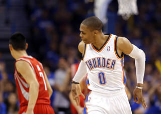 NBA BASKETBALL / CELEBRATION: Oklahoma City's Russell Westbrook (0) celebrates a three-point shot during Game 1 in the first round of the NBA playoffs between the Oklahoma City Thunder and the Houston Rockets at Chesapeake Energy Arena in Oklahoma City, Sunday, April 21, 2013. Photo by Sarah Phipps, The Oklahoman