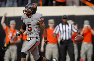 Oklahoma State's Josh Stewart (5) scores a touchdown during a college football game between Oklahoma State University (OSU) and the University of West Virginia at Boone Pickens Stadium in Stillwater, Okla., Saturday, Nov. 10, 2012. Photo by Bryan Terry, The Oklahoman