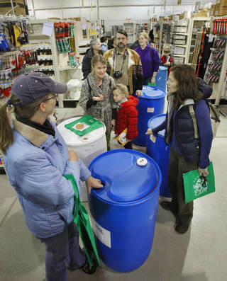 Norman residents line up to purchase accessories for their free rain barrels.