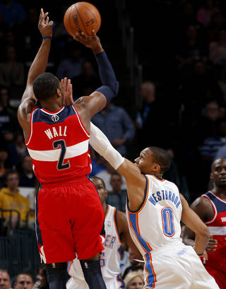 Oklahoma City's Russell Westbrook (0) defends Washington's John Wall (2) during an NBA basketball game between the Oklahoma City Thunder and the Washington Wizards at Chesapeake Energy Arena in Oklahoma City, Wednesday, March 19, 2013. Oklahoma City won 103-80. Photo by Bryan Terry, The Oklahoman