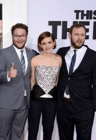 """Writer-directors Seth Rogen and Evan Goldberg flank Emma Watson, one of the many stars facing the apocalypse in """"This is the End."""""""