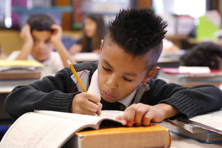 A student in Ms. Lopez' second grade classroom works on an assignment at his desk at Rockwood Elementary School on Tuesday, Dec. 3, 2013. Photo by Jim Beckel, The Oklahoman