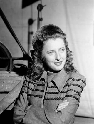 Barbara Stanwyck takes a breather between scenes on the Hollywood lot of Columbia Pictures July 10, 1941.(AP Photo)