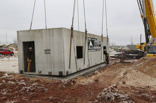 A monolithic safe space for a tornado-resistant house is installed at a job site in Moore. Montenero U.S. of Jacksonville, Fla., manufactures the concrete structures. Steve Gooch - The Oklahoman