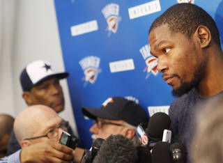Thunder forward Kevin Durant speaks to the media after practice at the Thunder Practice Facility in Oklahoma City on Monday, April 26, 2014. Photo by KT King/The Oklahoman