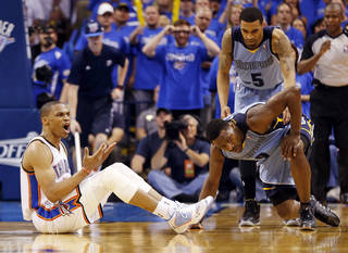 Oklahoma City's Russell Westbrook (0) reacts to a call against the Thunder in overtime near Memphis' Courtney Lee (5) and Tony Allen (9) during Game 2 in the first round of the NBA playoffs between the Oklahoma City Thunder and the Memphis Grizzlies at Chesapeake Energy Arena in Oklahoma City, Monday, April 21, 2014. Memphis won 111-105 in overtime. Photo by Nate Billings, The Oklahoman