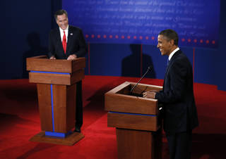 President Barack Obama and Republican presidential nominee Mitt Romney laugh during the first presidential debate at the University of Denver, Wednesday, Oct. 3, 2012, in Denver. (AP Photo/Pool, Rick Wilking) ORG XMIT: DBT540