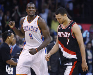Oklahoma City Thunder forward Serge Ibaka, left, of Republic of Congo, pumps his fist as Portland Trail Blazers guard Brandon Roy, right, walks off the court, at the end of an NBA basketball game in Oklahoma City, Friday, Nov. 12, 2010. Oklahoma City won 110-108. (AP Photo/Sue Ogrocki) ORG XMIT: OKSO113
