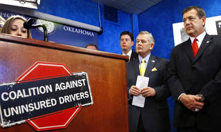 Insurance Commissioner John Doak, second from the right, appeared with nearly a dozen lawmakers at a press conference where he expressed support for legislation targeting the problem with uninsured drivers. The news conference was at the state Capitol Tuesday, Feb. 5, 2013. Speaking at the podium is Calley Herth, Oklahoma City, who told a story of an accident involving a family member and an uninsured driver. Photo by Jim Beckel, The Oklahoman