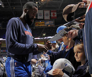 Fans get the autograph of Oklahoma City's James Harden before the NBA basketball game between the Denver Nuggets and the Oklahoma City Thunder in the first round of the NBA playoffs at the Oklahoma City Arena, Wednesday, April 27, 2011. Photo by Bryan Terry, The Oklahoman