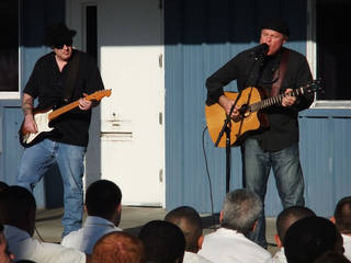 Matt Blagg, at right, performs a song in a prison yard as part of a Bill Glass Weekend for Life prison ministry event. Photo provided
