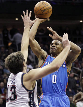 Oklahoma City Thunder's Russell Westbrook (0) shoots past New Jersey Nets' Mehmet Okur (13), of Turkey, during the third quarter of an NBA basketball game in Newark, N.J., Saturday, Jan. 21, 2012. Westbrook contributed 21 points as the Thunder won 84-74. (AP Photo/Mel Evans) ORG XMIT: NJME122