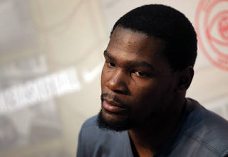 Oklahoma City Thunder NBA basketball player Kevin Durant listens to a reporter during a press conference in Paris as part as a visit to France, Wednesday, Sept. 4, 2013. (AP Photo/Christophe Ena)