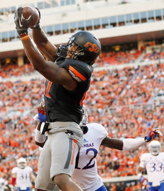 Oklahoma State's Tracy Moore (87) makes a touchdown catch in the second quarter in front of KU's Dexter McDonald (12) during a college football game between the Oklahoma State University Cowboys (OSU) and the University of Kansas Jayhawks (KU) at Boone Pickens Stadium in Stillwater, Okla., Saturday, Nov. 9, 2013. Photo by Nate Billings, The Oklahoman