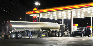 In this photo taken Nov. 20, 2009, a tanker truck makes a fuel delivery at a Little Rock, Ark., gas station. Retail gasoline prices headed downward to begin one of the country's busiest travel weeks, with more than 33 million people expected to hit the road for the Thanksgiving holiday. AP Photo Danny Johnston - AP