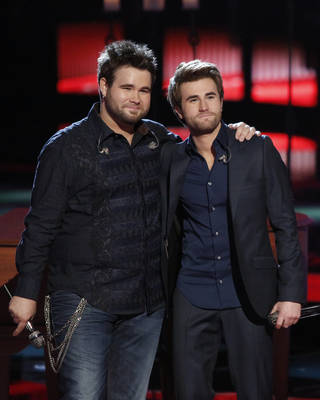 "This June 17, 2013 image released by NBC shows Muskogee duo Zach Swon, left, and Colton Swon of The Swon Brothers, on stage during the singing competition series ""The Voice,"" in Los Angeles. The Swon Brothers finished third to runner-up Michelle Chamuel and winnner Danielle Bradbery in the finale on Tuesday. (Photo by: Tyler Golden/NBC) Tyler Golden - AP"