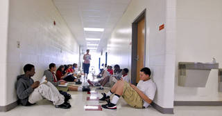 John Marshall High School math teacher Cassi Yarbrough teaches in the hallway while there was no air conditioning at John Marshall High School on Friday in Oklahoma City. Photo by Chris Landsberger, The Oklahoman
