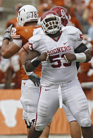 REACTION: Oklahoma's Casey Walker (53) reacts after a defensive stop during the Red River Rivalry college football game between the University of Oklahoma Sooners (OU) and the University of Texas Longhorns (UT) at the Cotton Bowl in Dallas, Saturday, Oct. 8, 2011. Photo by Chris Landsberger, The Oklahoman ORG XMIT: KOD