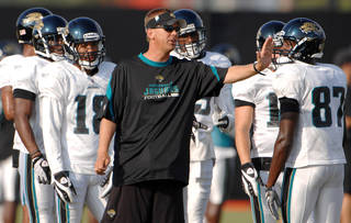 Jacksonville Jaguars receivers coach Todd Monken (front) gives directiions to the receiver group during the Jags training camp practice session Thursday morning August 13, 2009 at the practice facility adjacent to Jacksonville Municipal Stadium in Jacksonville, Fl. PHOTO COURTESY THE FLORIDA TIMES-UNION