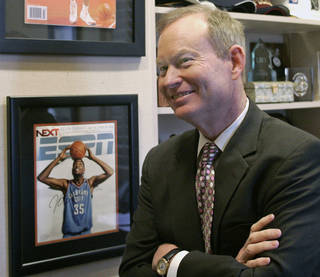 This March 29, 2010, photo shows Oklahoma City Mayor Mick Cornett smiling in his office, next to a copy of ESPN magazine with a photo of Oklahoma Ctiy Thunder NBA basketball player Kevin Durant on the cover, in Oklahoma City. (AP Photo/Sue Ogrocki)