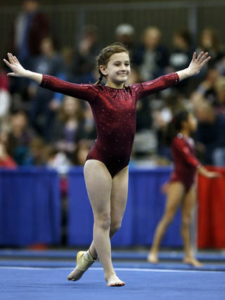 Hallie Robertson, 9, from McCracken's Gymnastics in Olate, Kansas, competes in the floor exercise during the Nadia Comaneci Invitational Sports Festival on Saturday, Feb. 16, 2013 in Oklahoma City, Okla. Photo by Steve Sisney, The Oklahoman