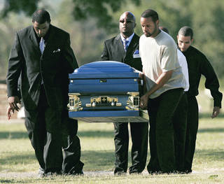 Pallbearers carry the casket of the Rev. Carol Daniels on Monday at Arlington Memorial Gardens in Oklahoma City before her burial. PHOTO BY JOHN CLANTON, THE OKLAHOMAN