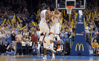 Oklahoma City Thunder small forward Kevin Durant (35) and Oklahoma City Thunder point guard Russell Westbrook (0) react after Westbrook's three pointer to seal the 115-104 win over Phonenix during the NBA basketball game between the Oklahoma City Thunder and the Phoenix Suns at the Chesapeake Energy Arena on Wednesday, March 7, 2012 in Oklahoma City, Okla. Photo by Chris Landsberger, The Oklahoman