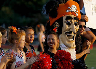 The Putnam City High School mascot gets cheers for the team before Putnam City's football game against Sapulpa at Putnam City. Photo by Bryan Terry, The Oklahoman Bryan Terry - THE OKLAHOMAN