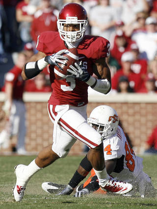 OU's Jonathan Nelson (3) intercepts a Zac Robinson pass intended for OSU's Hubert Anyiam (84) during the second half of the Bedlam college football game between the University of Oklahoma Sooners (OU) and the Oklahoma State University Cowboys (OSU) at the Gaylord Family-Oklahoma Memorial Stadium on Saturday, Nov. 28, 2009, in Norman, Okla. Photo by Sarah Phipps, The Oklahoman