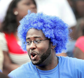 Millwood alumnus Jay Shanks wears a colorful wig while sitting in the stands with some of his classmates from Millwood's class of 2003 who came to watch the Soul Bowl between the Douglass Trojans and the Millwood Falcons. Shanks said he played on the football team when he attended Millwood High School. Photo by Jim Beckel, The Oklahoman. Jim Beckel - THE OKLAHOMAN