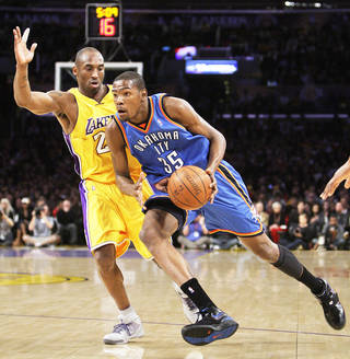 The Lakers' Kobe Bryant, left, pressures the Thunder's Kevin Durant on Tuesday. AP photo