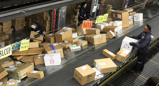 FILE - In this Dec. 11, 2012 file photo, FedEx workers sort packages at the Oakland Regional Sort Facility in Oakland, Calif. A storm bringing heavy winds and snow to much of the Midwest on Thursday, Dec. 20 ¬aa the heaviest shipping day of the year ¬aa could mean that some packages might not make it under the tree in time for Christmas. (AP Photo/Ben Margot, File) ORG XMIT: NY123