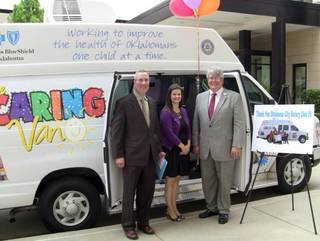 Patrick Raglow, executive director at Catholic Charities Oklahoma City, Brooke Townsend, manager of the Oklahoma Caring Foundation, and Robert Clements, executive vice president at Clements Foods, with the Caring Van made possible by Oklahoma City Rotary Club 29. Raglow and Clements are Rotarians. Photo provided PROVIDED