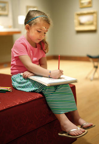 Taylor Austin, of Yukon, draws during family day on April 13 at the Oklahoma City Museum of Art. Photo by Sarah Phipps, The Oklahoman SARAH PHIPPS - SARAH PHIPPS