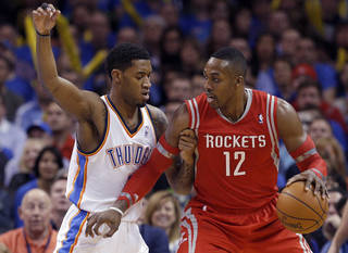 OKC's Perry Jones, left, defends Houston's Dwight Howard during a game earlier this season. With starter Serge Ibaka out, Jones could be called upon to provide a defensive boost against San Antonio in the Western Conference Finals. Photo by Sarah Phipps, The Oklahoman