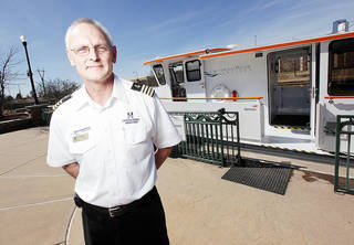 Oklahoma River boat Capt. Jerry Lojka poses for a photo near The Devon Explorer in Oklahoma City, Wednesday, Feb. 22, 2012. Photo by Nate Billings, The Oklahoman