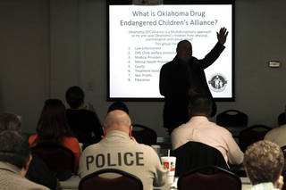 Dub Turner trains law enforcement, child welfare workers and prosecutors on Thursday, Aug. 15, 2013 in Norman, Okla. about what to do when children are found in drug homes. Photo by Steve Sisney, The Oklahoman