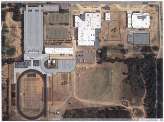 This is an aerial view of what the Harrah High School campus area would look like if the Harrah school board schedules a vote and voters approve a $36.47 million bond issue. Architect's rendering provided Prepress