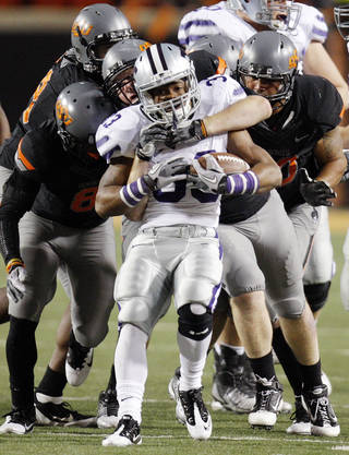 The OSU defense stops Kansas State's John Hubert (33) during a college football game between the Oklahoma State University Cowboys (OSU) and the Kansas State University Wildcats (KSU) at Boone Pickens Stadium in Stillwater, Okla., Saturday, Nov. 5, 2011. Photo by Nate Billings, The Oklahoman