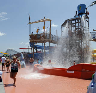 Visitors are drenched as a giant water bucket spills its contents at Andy Alligator's Fun Park. PHOTO BY STEVE SISNEY, THE OKLAHOMAN STEVE SISNEY -