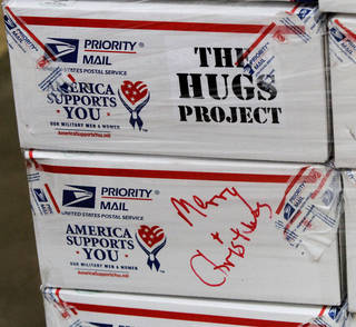Merry Christmas is written on a HUGS care package. Photo by Jim Beckel, The Oklahoman