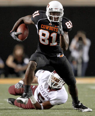 OSU's Justin Blackmon runs past Texas A&M's Coryell Judie during the college football game between Texas A&M University and Oklahoma State University (OSU) at Boone Pickens Stadium in Stillwater, Okla., Thursday, Sept. 30, 2010. Photo by Bryan Terry, The Oklahoman