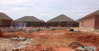 Piping loops that will be tied into the geothermal unit of a home are shown at this home construction site. The loops go 250 feet under ground. - PROVIDED BY IDEAL HOMES