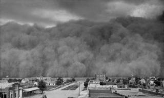 OU football helped the state move beyond the image of the Dust Bowl, shown here towering over the Panhandle town of Hooker on June 4, 1937. OKLAHOMAN ARCHIVES