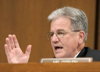 FILE - In this June 29, 2010 file photo, Sen. Tom Coburn, R-Okla., gestures on Capitol Hill in Washington. Is anyone going to fix Social Security? Medicare? Medicaid? They're the big bills coming due. While President Barack Obama and congressional leaders offer vague assurances, six senators _ three Republicans and three Democrats whose ideologies cover the entire liberal-conservative spectrum _ are quietly taking up the baton. (AP Photo/Susan Walsh, File) ORG XMIT: WX206