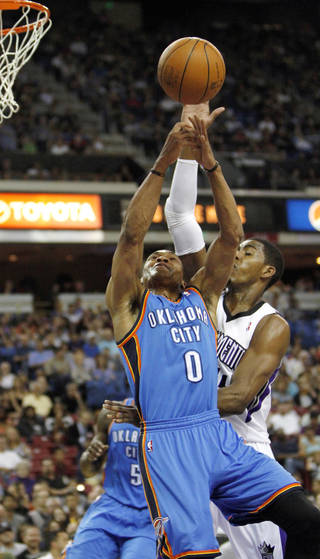 Oklahoma City Thunder guard Russell Westbrook (0) battles Sacramento Kings forward Jason Thompson for the rebound during the first quarter of an NBA basketball game in Sacramento, Calif., Friday, April 20, 2012. (AP Photo/Rich Pedroncelli) ORG XMIT: SCA104