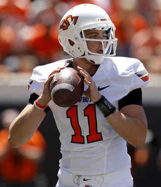 OSU's Wes Lunt drops back to pass during Oklahoma State's spring football game at Boone Pickens Stadium in Stillwater, Okla., Saturday, April 21, 2012. Photo by Bryan Terry, The Oklahoman BRYAN TERRY