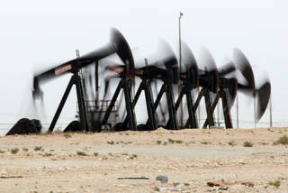 A row of oil pumps work in the desert oil fields of Sakhir, Bahrain. AP File Photo Hasan Jamali - AP